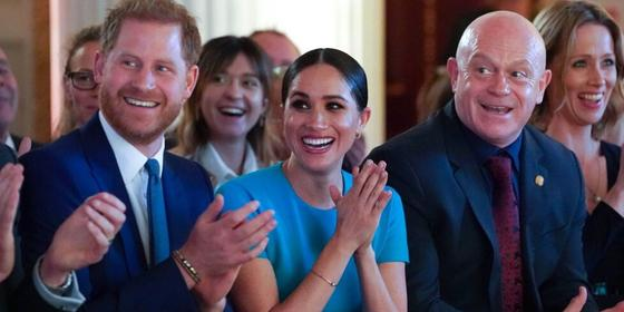 Meghan Markle and Prince Harry's reaction to a couple's surprise engagement is so cute