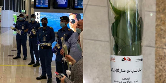 Dubai airport welcomes people arriving from Beirut with white roses