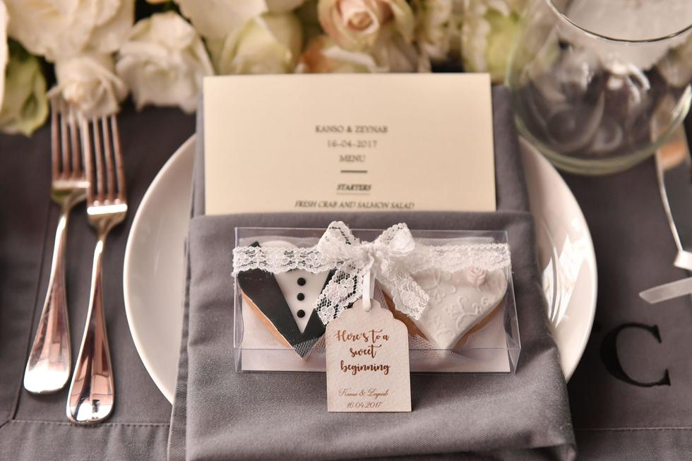 """""""We wanted to focus on meaningful ideas such as special quotes while having a very soft peach flower arrangement in line with the big slate and wooden structure of the venue and we had a video booth for everyone to leave us messages."""""""
