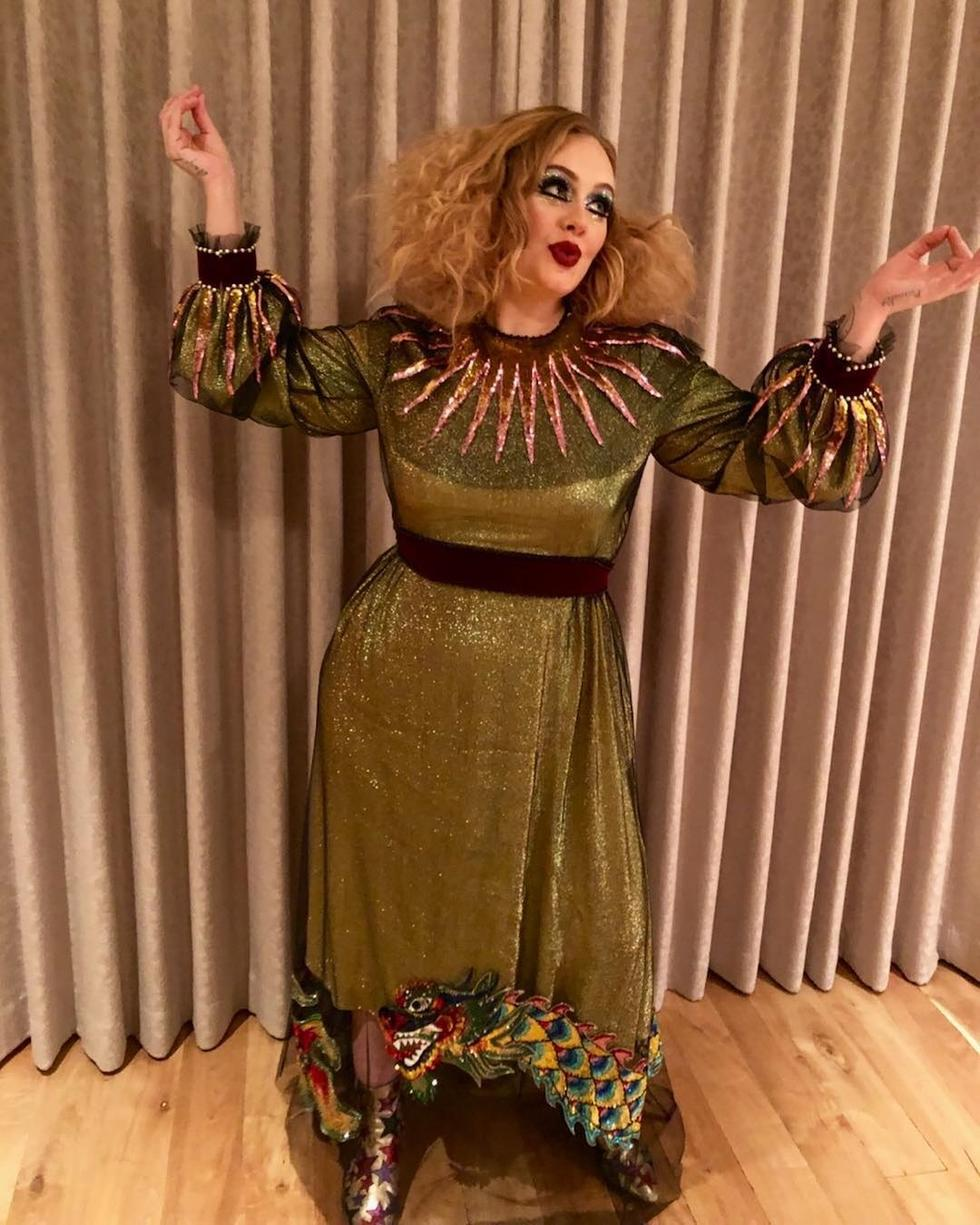 Adele is giving us all the jester vibes as she flaunted the green dress with a super glittery make-up look.
