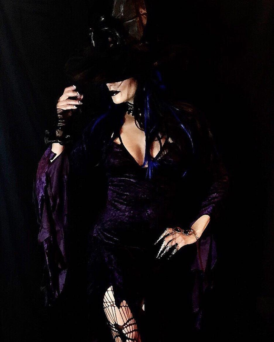 Halle Berry went all out this Halloween and killed the spider witch look.