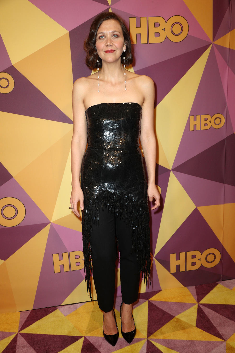 Maggie Gyllenhaal in an outfit by Monse teamed with Sophie Buhai earrings