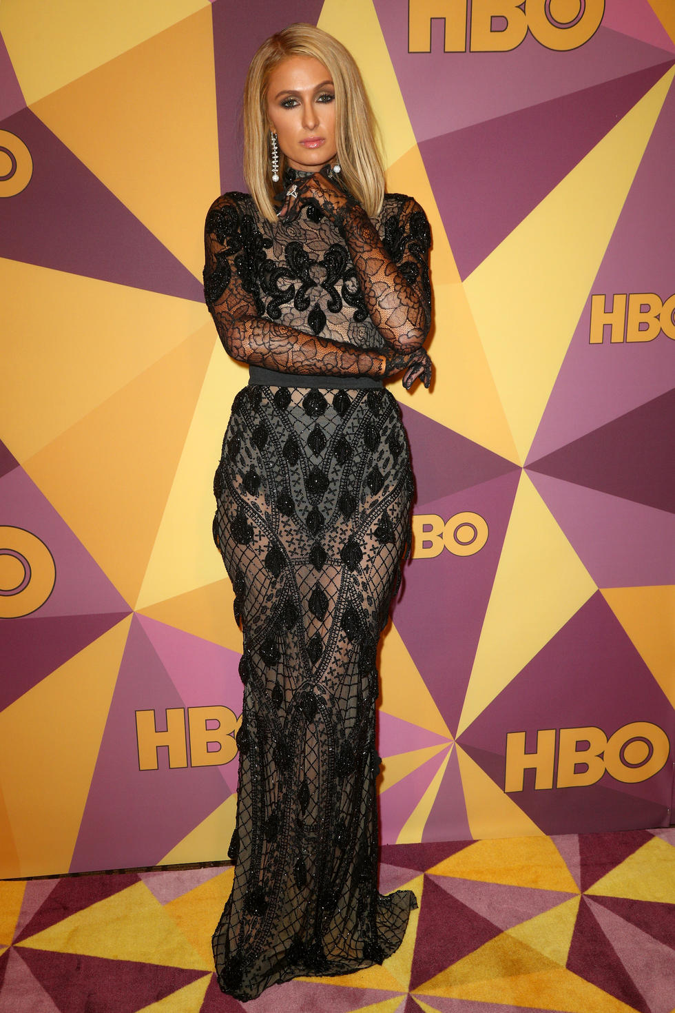 A newly engaged Paris Hilton makes a glam entrance in Elie Madi