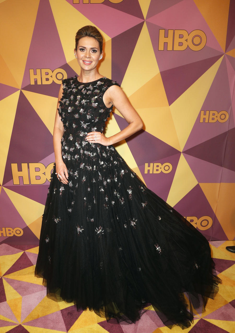 British television presenter and actor Carly Steel wearing Christian Siriano paired with Massimo jewels
