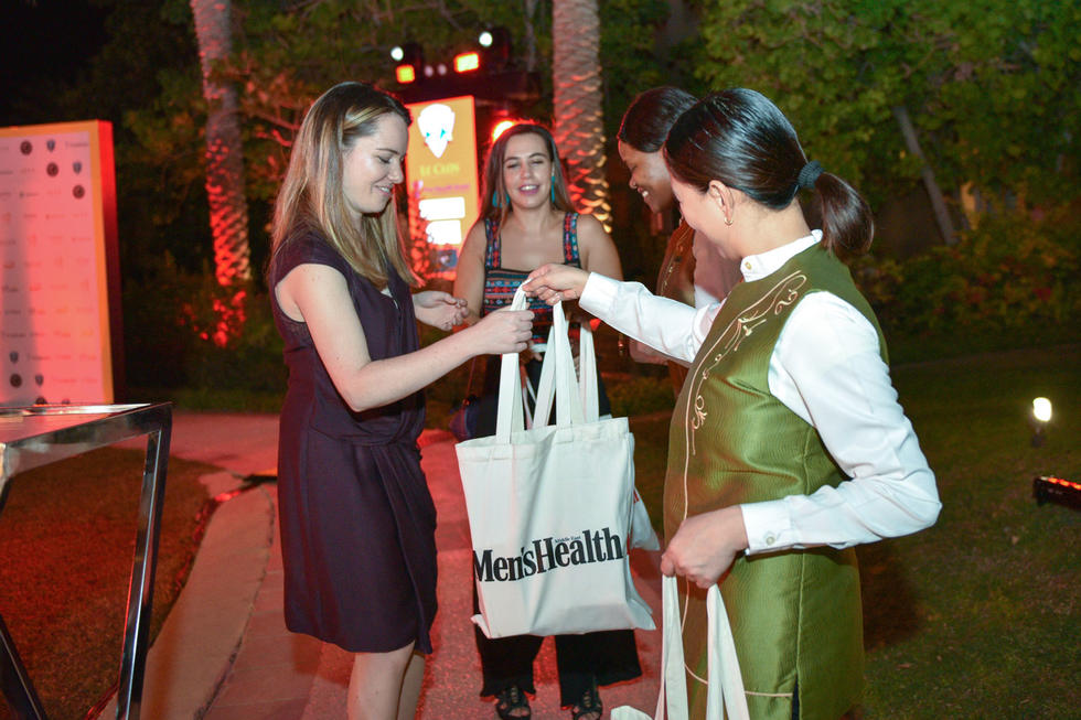 Guests receiving their goodie bags were all smiles.