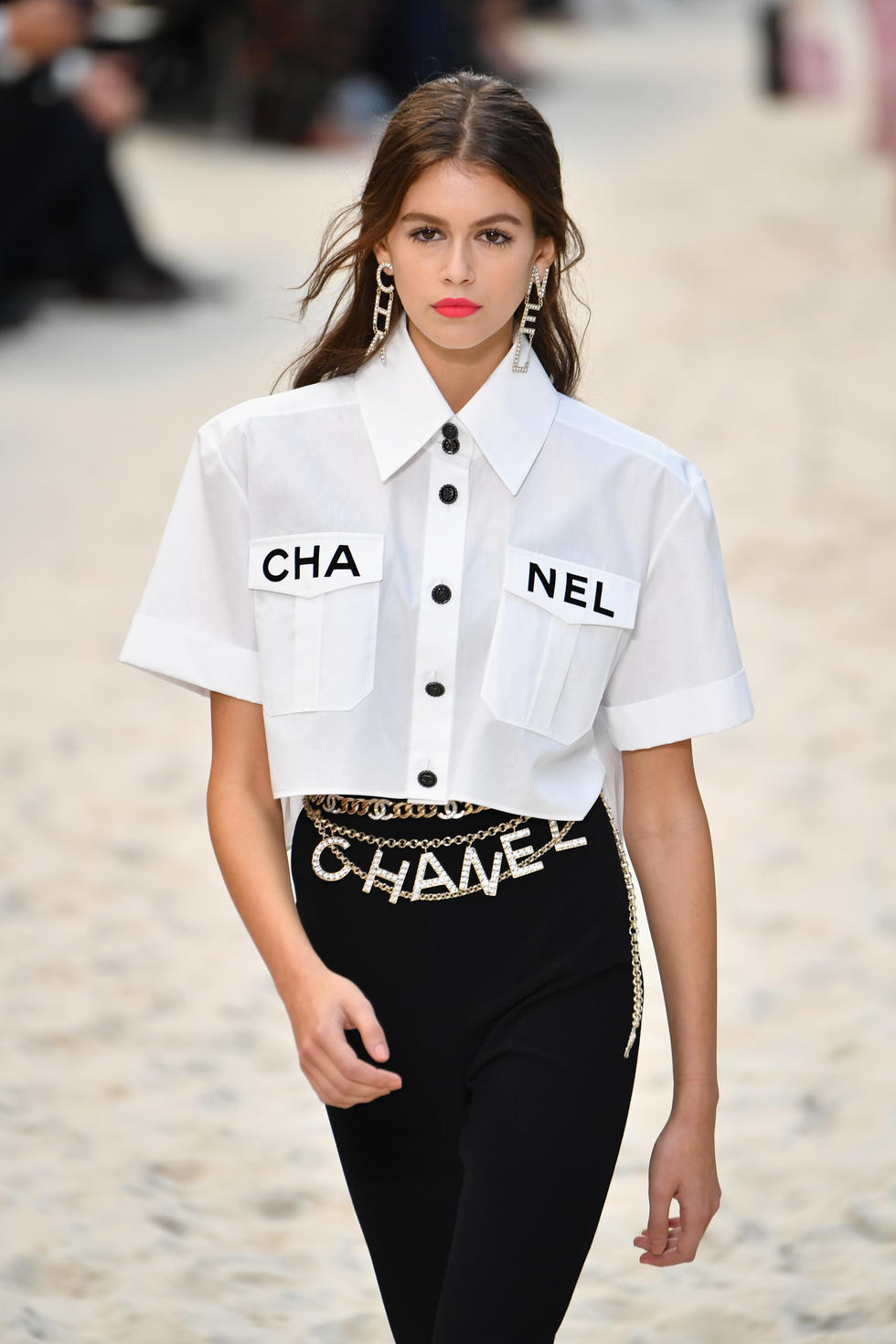 ALPHABET CHARMS -  Yeah, it's a little strange, but we're digging the way it looks. Tell the world what you're wearing without saying a word.  Chanel SS19