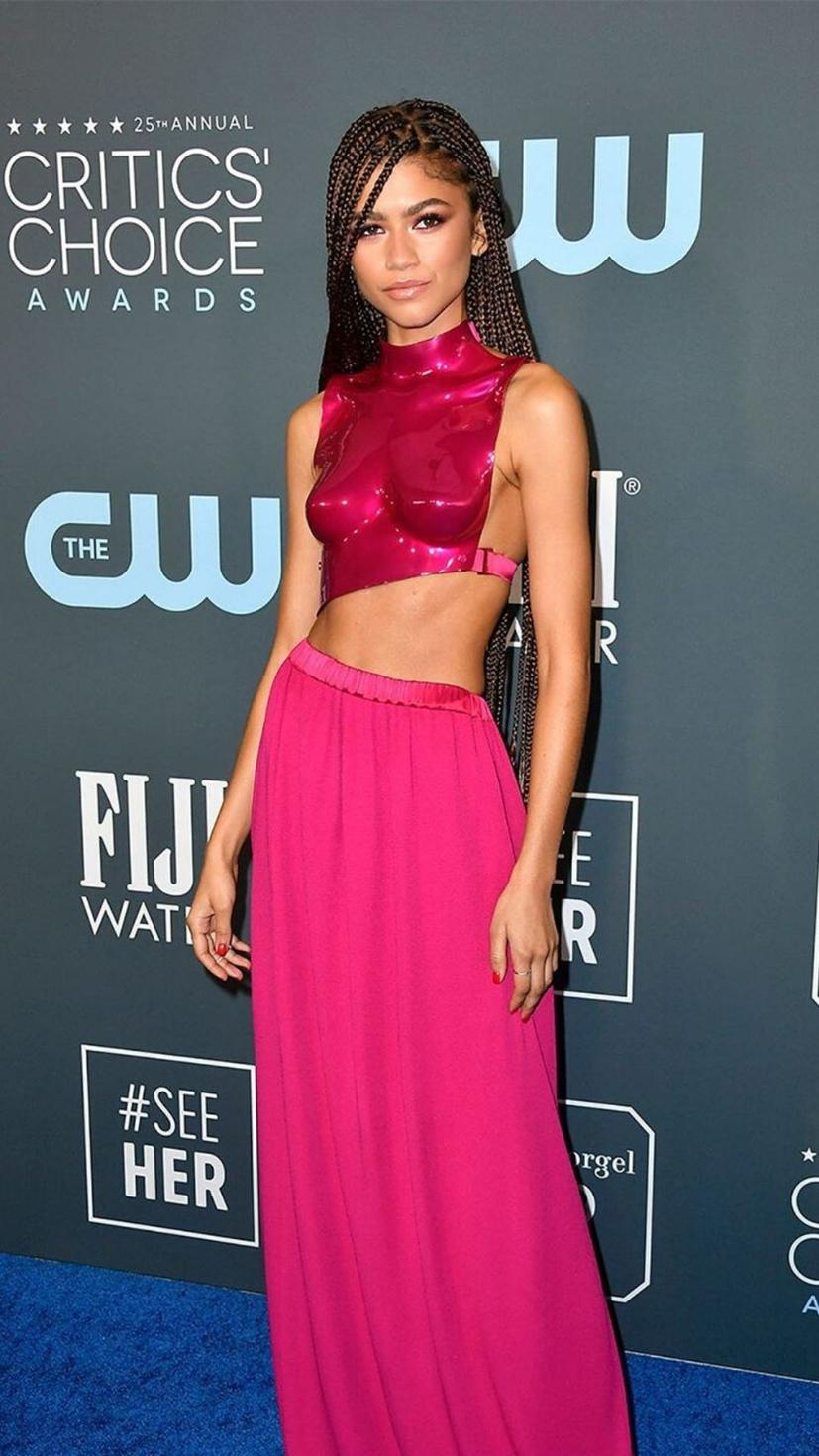 Zendaya wears a Tom Ford hot pink outfit, molded bodice and all.