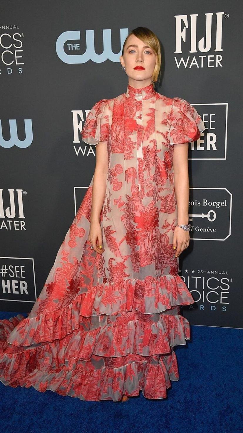 Saoirse Ronan wears a floral Erdem dress and Tamara Mellon heeled sandals.