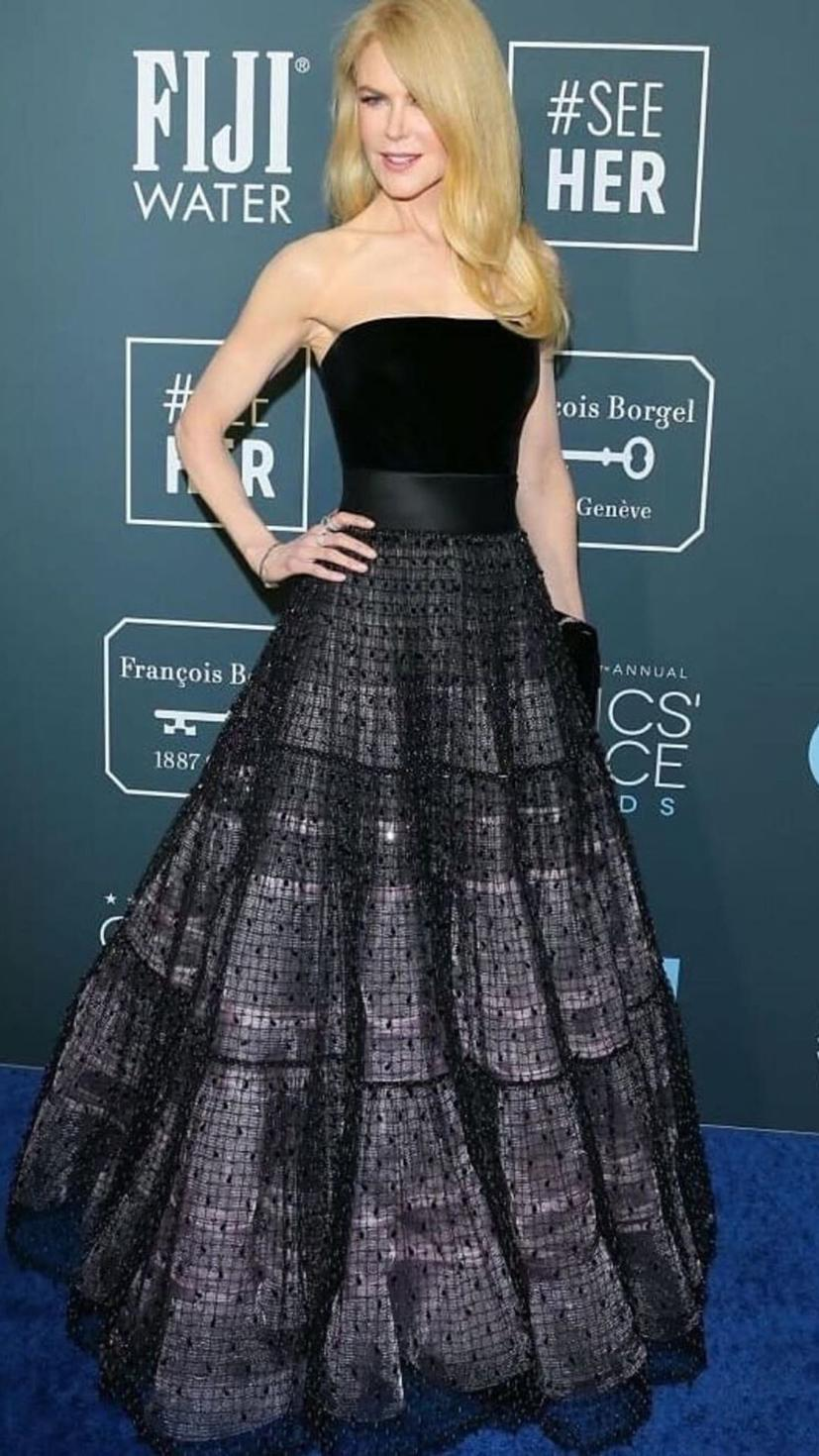 Nicole Kidman wears a black dazzling Armani gown, Omega jewels and Harry Winston jewels.