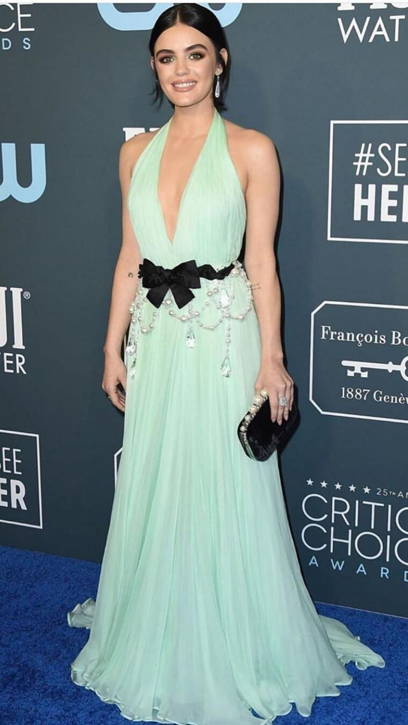 Lucy Hale wears a mint Miu Miu gown, Djula jewellery and Jimmy Choo shoes.