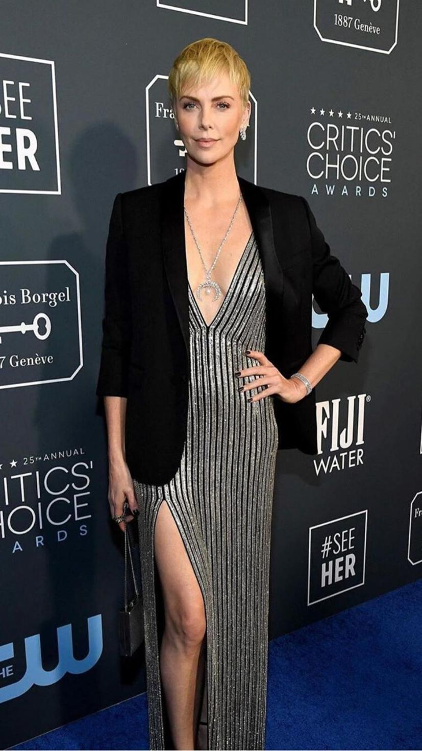 Charlize Theron wears a Celine gown and blazer, and Messika jewellery.