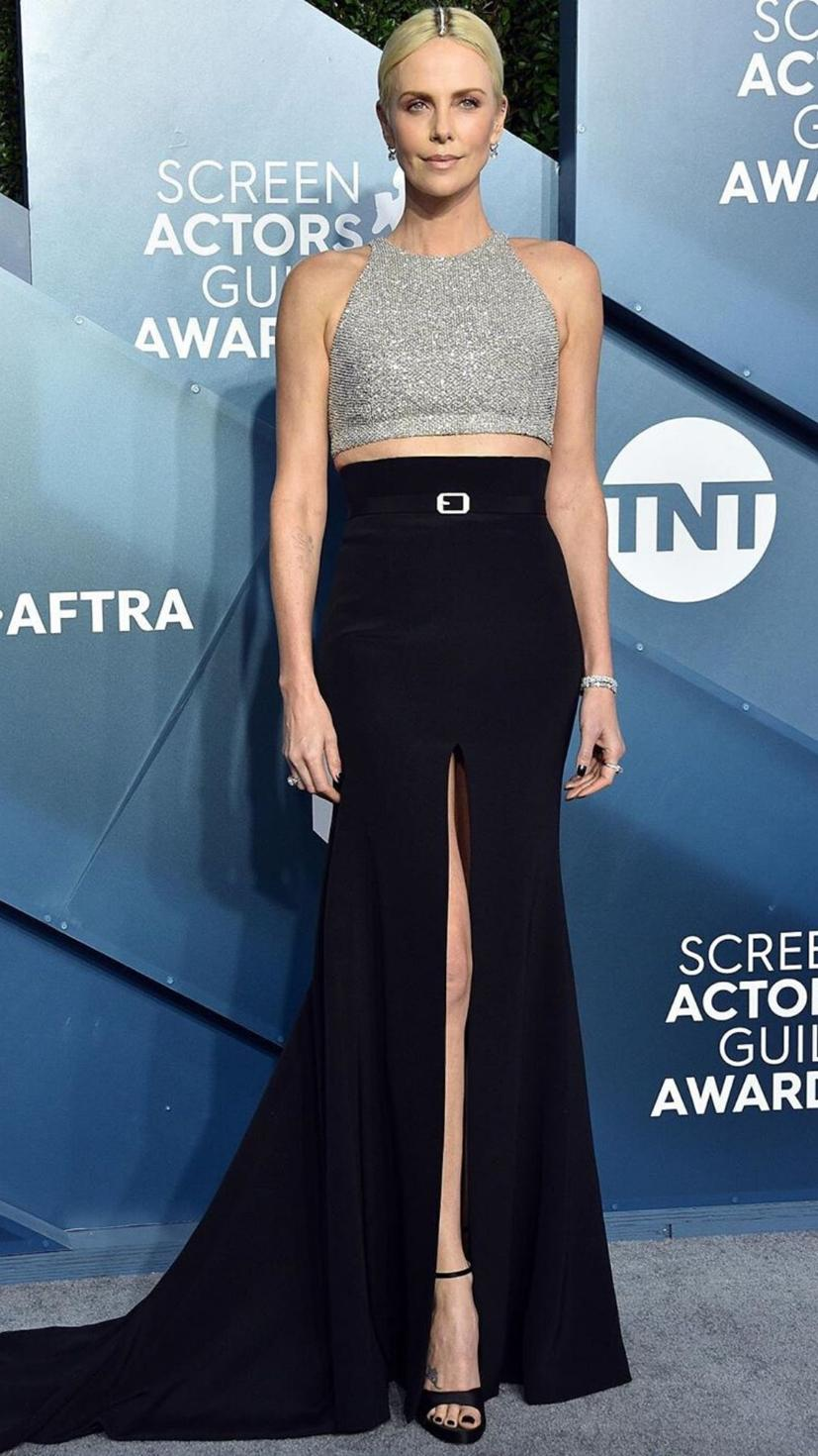 Charlize Theron wore a Givenchy two piece with a leg slit and black heels
