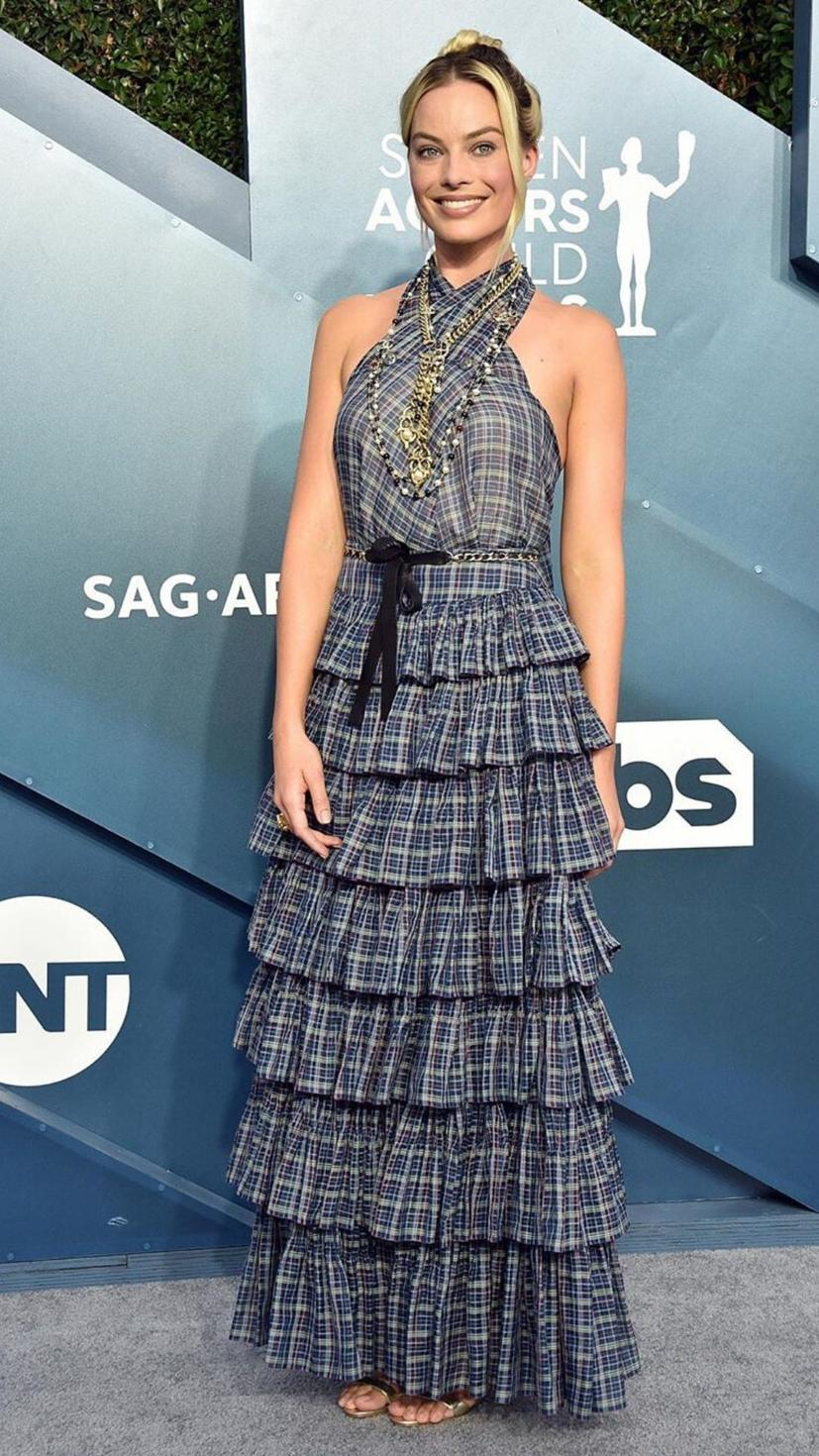 Margot Robbie wears a Chanel gown with Chanel jewellery to match