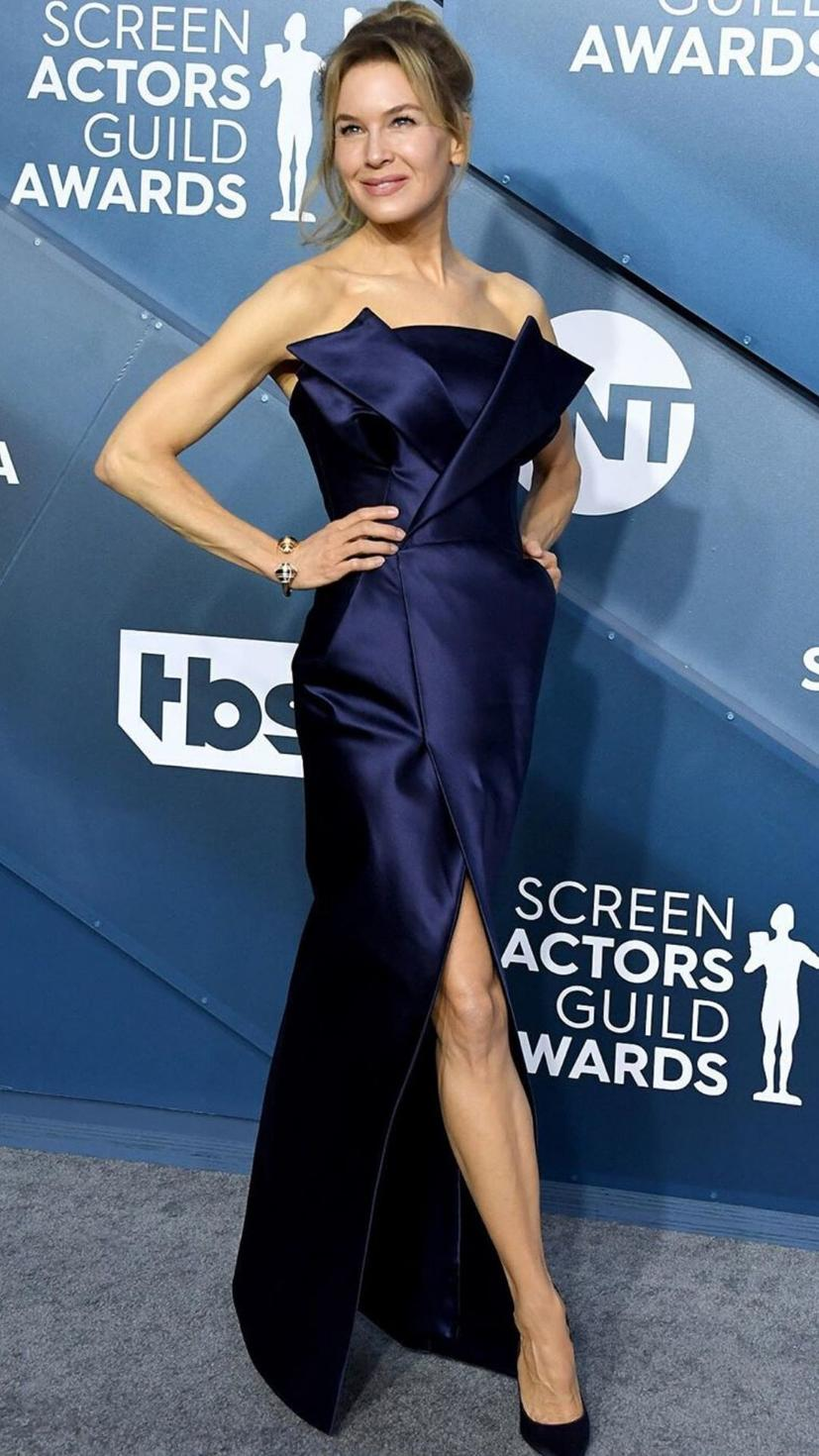 Renee Zellweger wears a satin Maison Margiela gown with Jimmy Choo shoes and Cartier jewellery