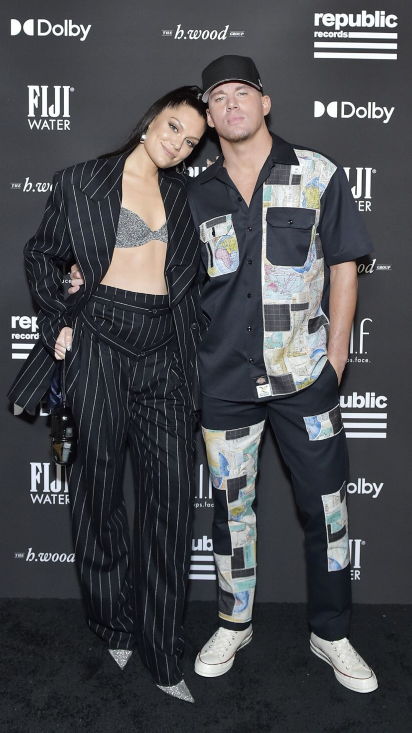 Jessie J wears a striped suit with a silver bra, while Channing Tatum wears a set from Orah LeMaitre