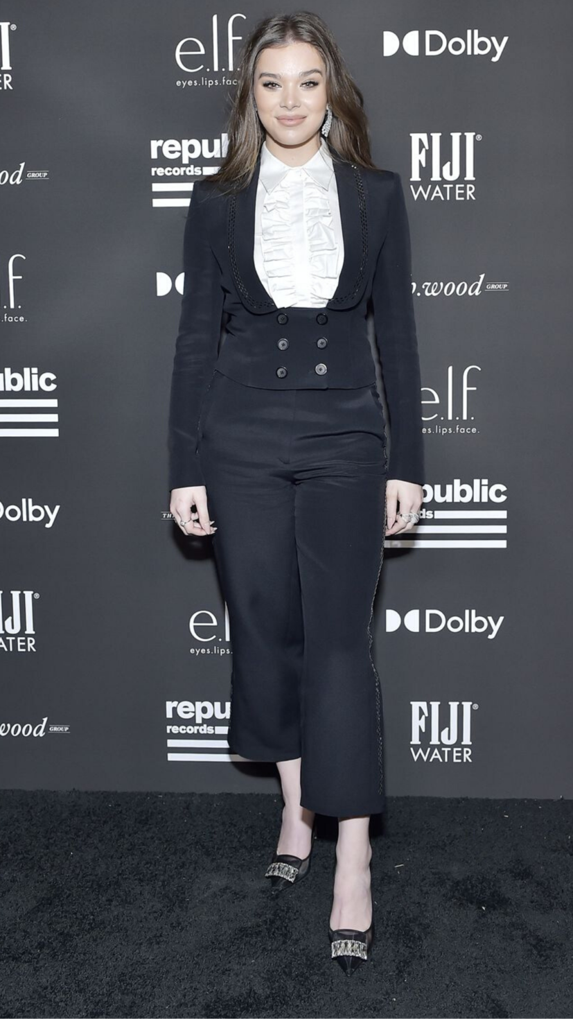 Hailee Steinfeld wears a black and white Victorian-era inspired suit