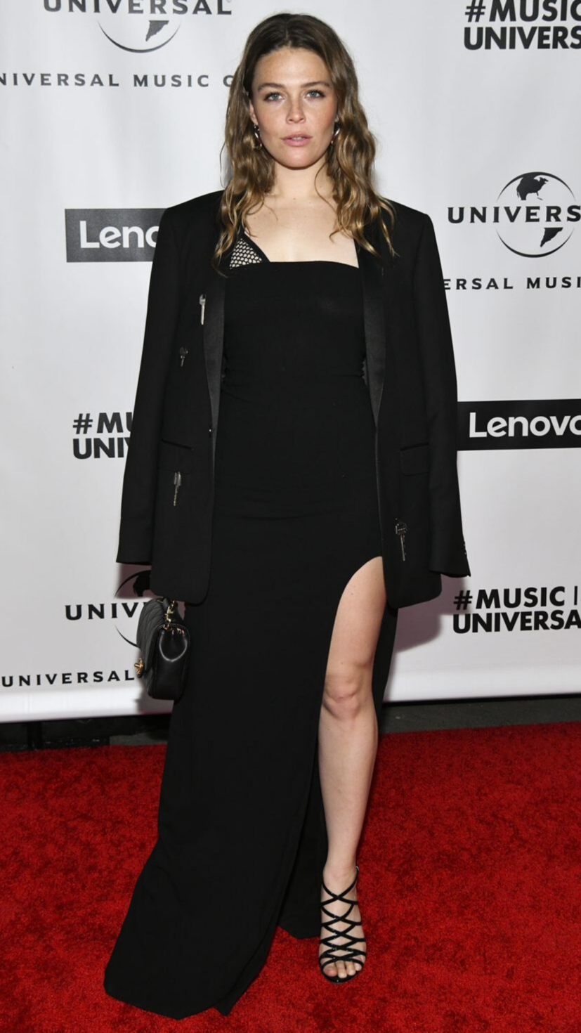 Maggie Rogers wears a black dress with a matching Chanel bag