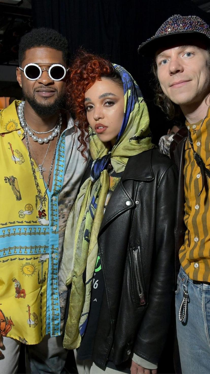 Usher wears a blouse from Lost Daze Ca and jewellery from Lorraine Schwarrtz
