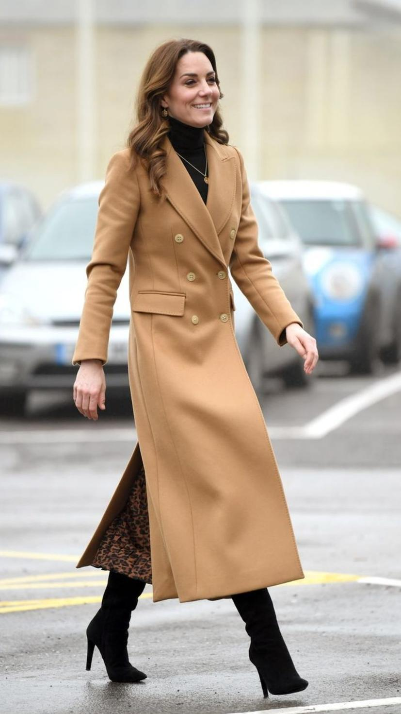 The Duchess of Cambridge steps out in a brown camel Massimo Dutti coat, a Zara dress and Ralph Lauren boots