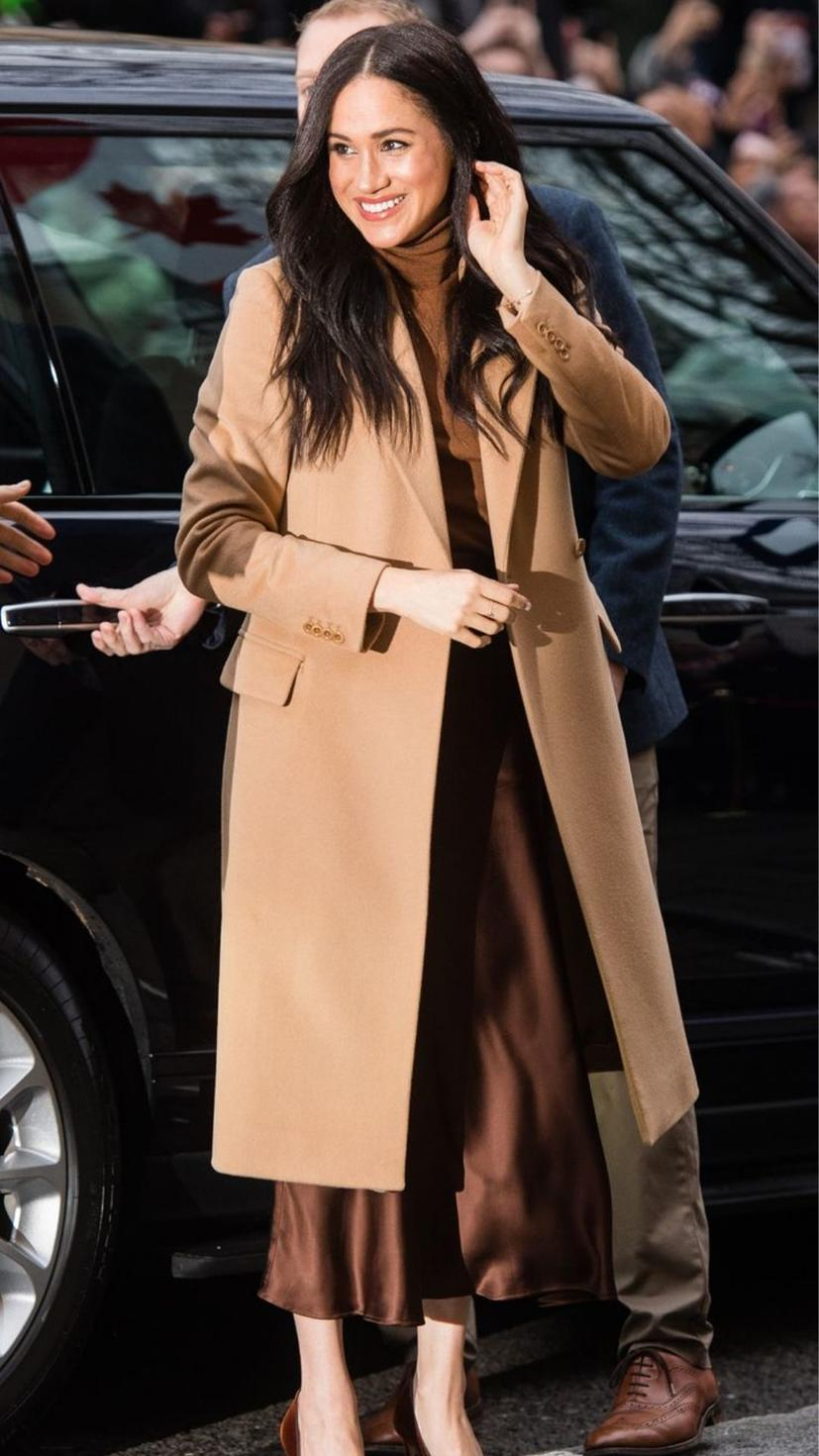 Meghan Markle steps out in a brown camel coat from Reiss