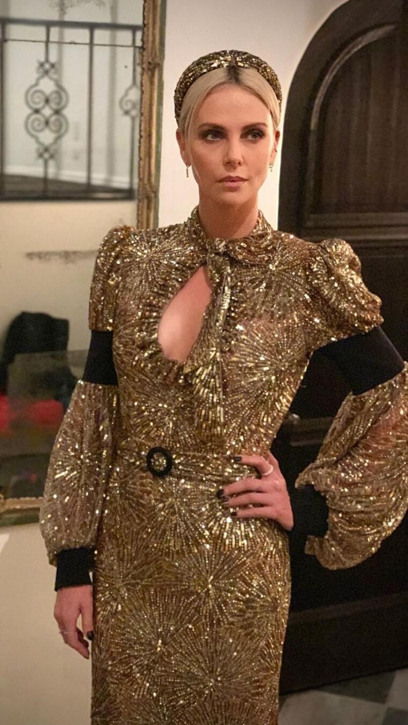Charlize Theron in a dazzling gold Louis Vuitton ensemble