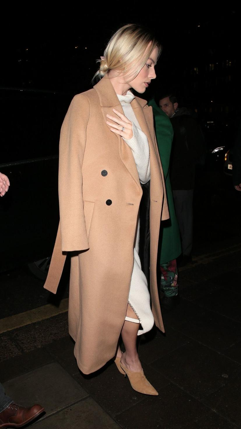 Margot Robbie was spotted in London wearing a belted wool coat from Mango