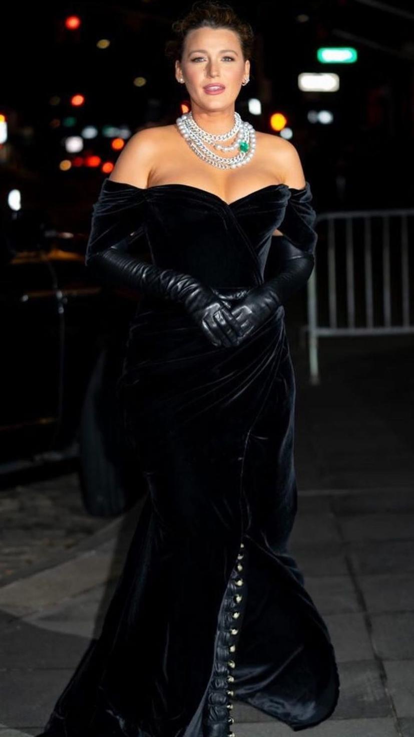 Blake Lively wears a black velvet off-the-shoulder gown by Dolce & Gabbana with Lorraine Schwartz jewellery