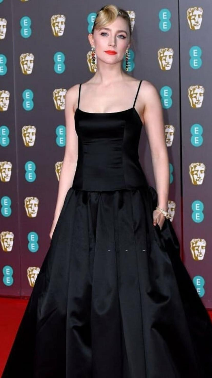 Saoirse Ronan wears a black gown and jewellery from Gucci