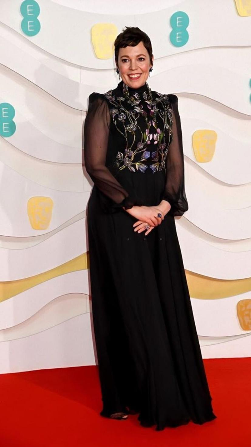 Olivia Colman wears a dress from Alexander Mcqueen with matching jewellery from Atelier Swarovski