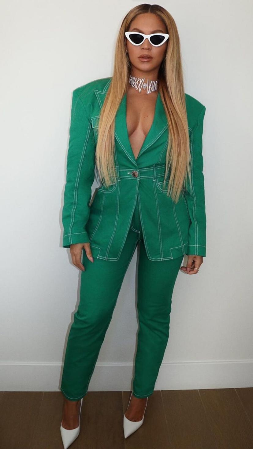 Beyonce attends the Super Bowl in a Balmain Spring 2020 green blazer and trousers with Messika jewellery and white pumps by Le Silla