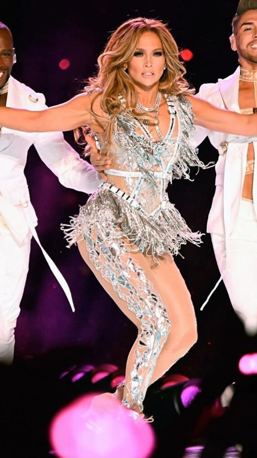 JLO wears a silver toned Versace bodysuit for her Super Bowl performance