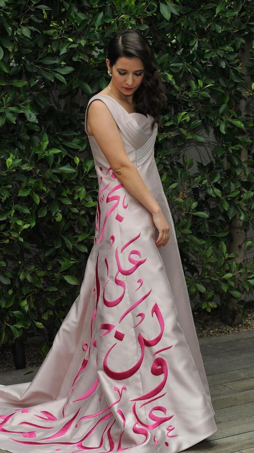 Waad Alkateab, 'For Sama's' director, wears a gown by Syrian designer Reem Masri with calligraphy by Akil Artwork