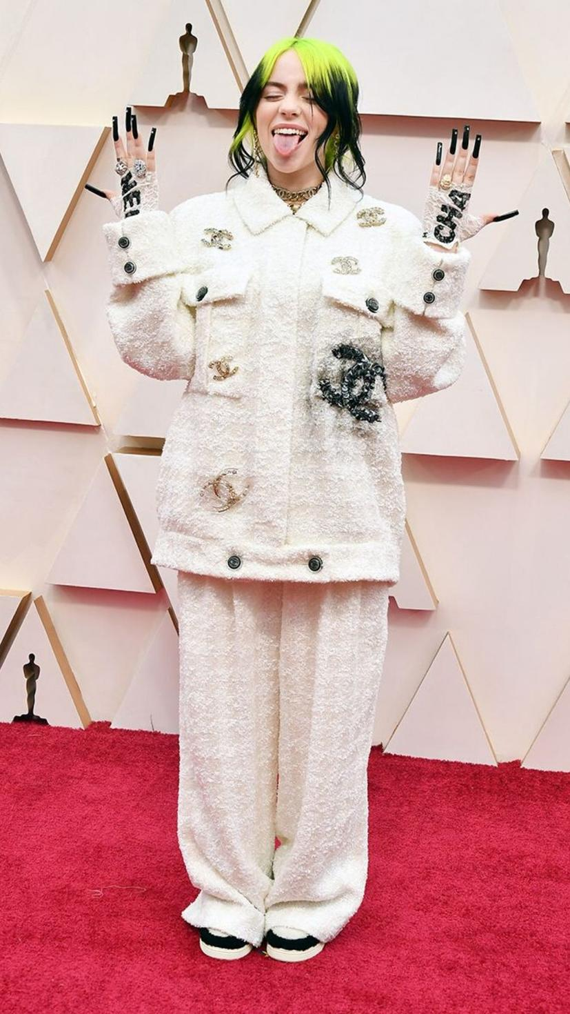 Billie Eilish wears a suit and jewellery from Chanel