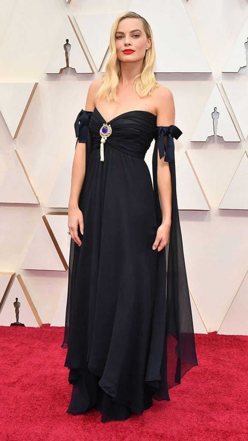 Margot Robbie wears a gown and jewellery from Chanel