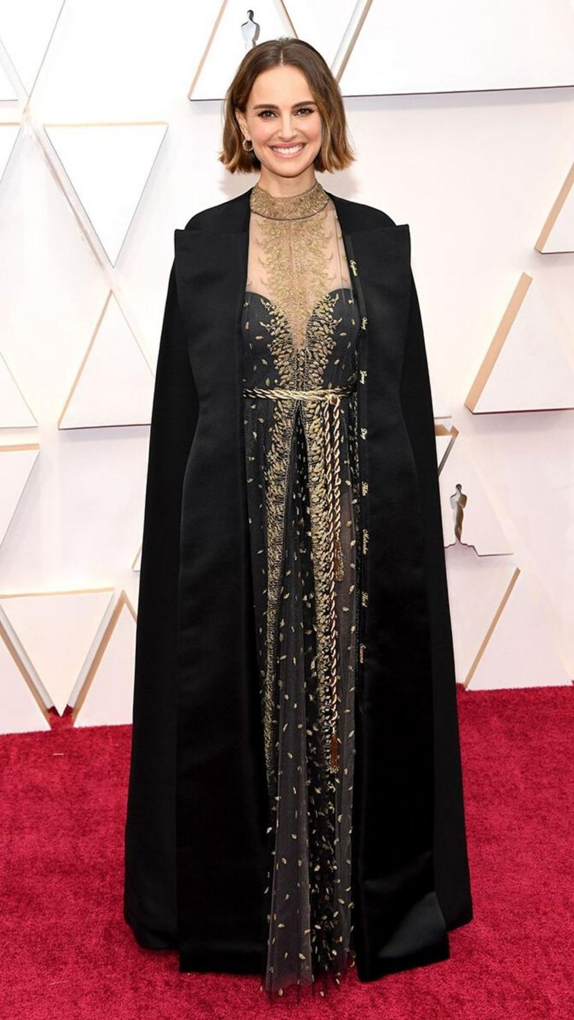 Natalie Portman wears a gown from Dior and jewellery from Cartier
