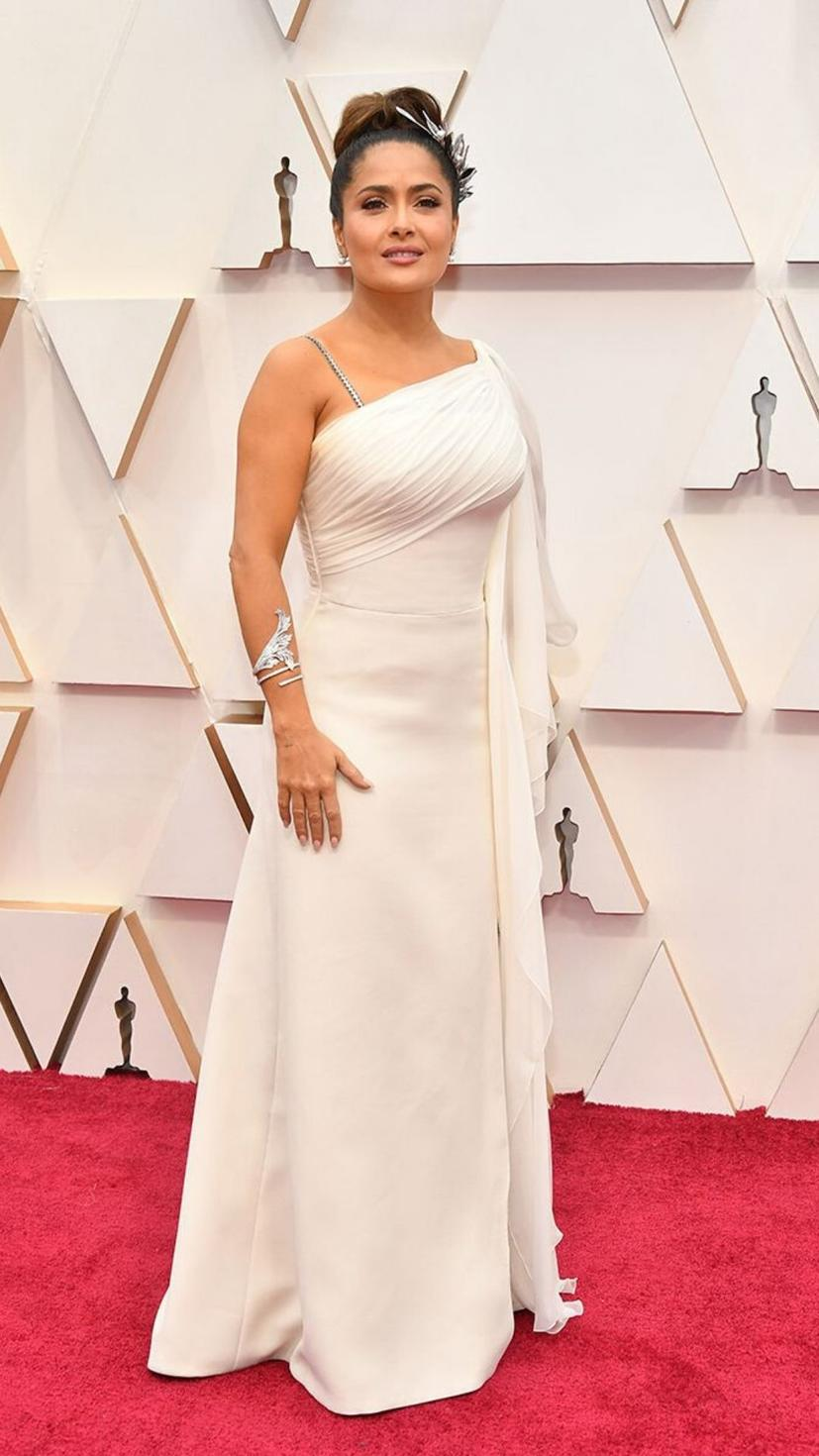 Salma Hayek wears a gown from Gucci and jewellery from Boucheron