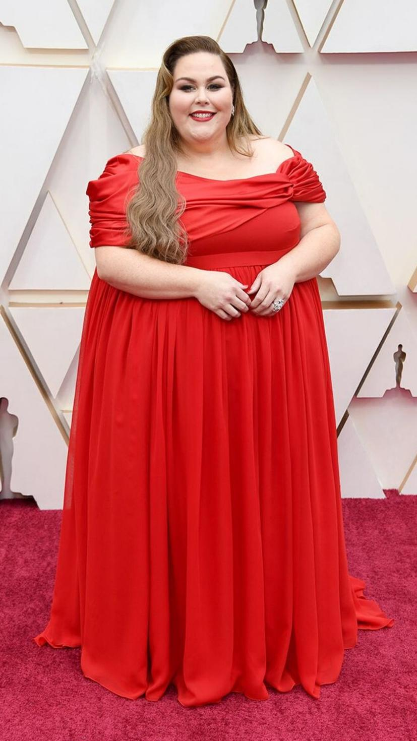 Chrissy Metz wears a gown from Christian Siriano and jewellery from Forevermark