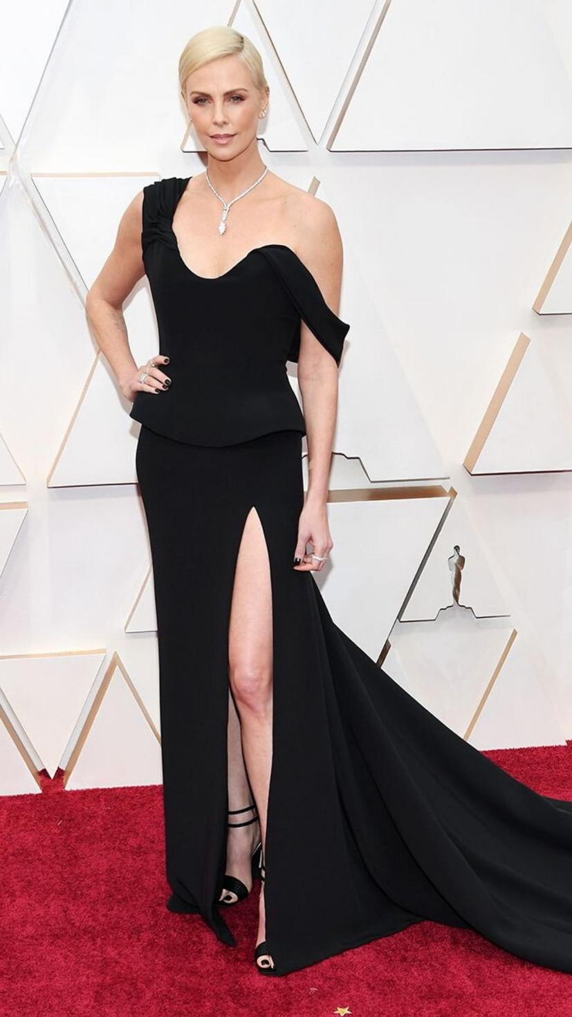 Charlize Theron wears a gown from Dior and jewellery from Tiffany & Co.