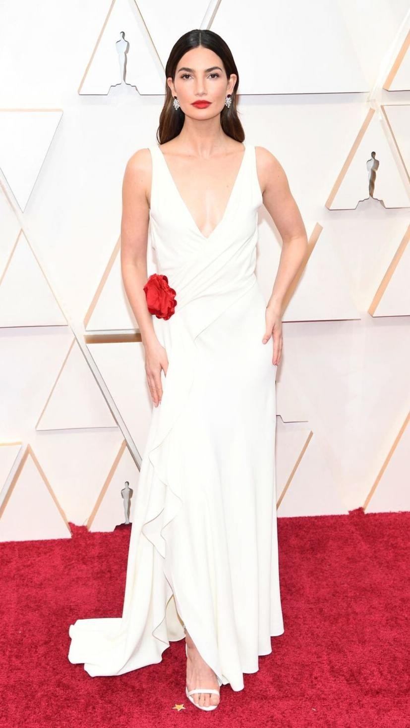 Lily Aldridge wears a dress from Ralph Lauren, heels from Jimmy Choo, and jewellery from Bulgari