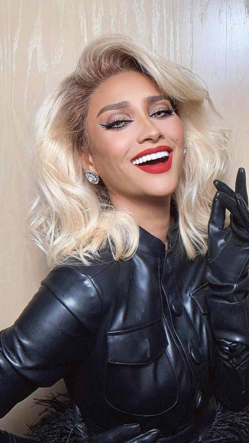 "Blonde hair and black leather - the perfect combo! In the words of T-Swift, she's got ""that red-lipped, classic thing"" that we like! Eyeliner? Check. Bold lashes? Check. Beautiful smile? Check!"