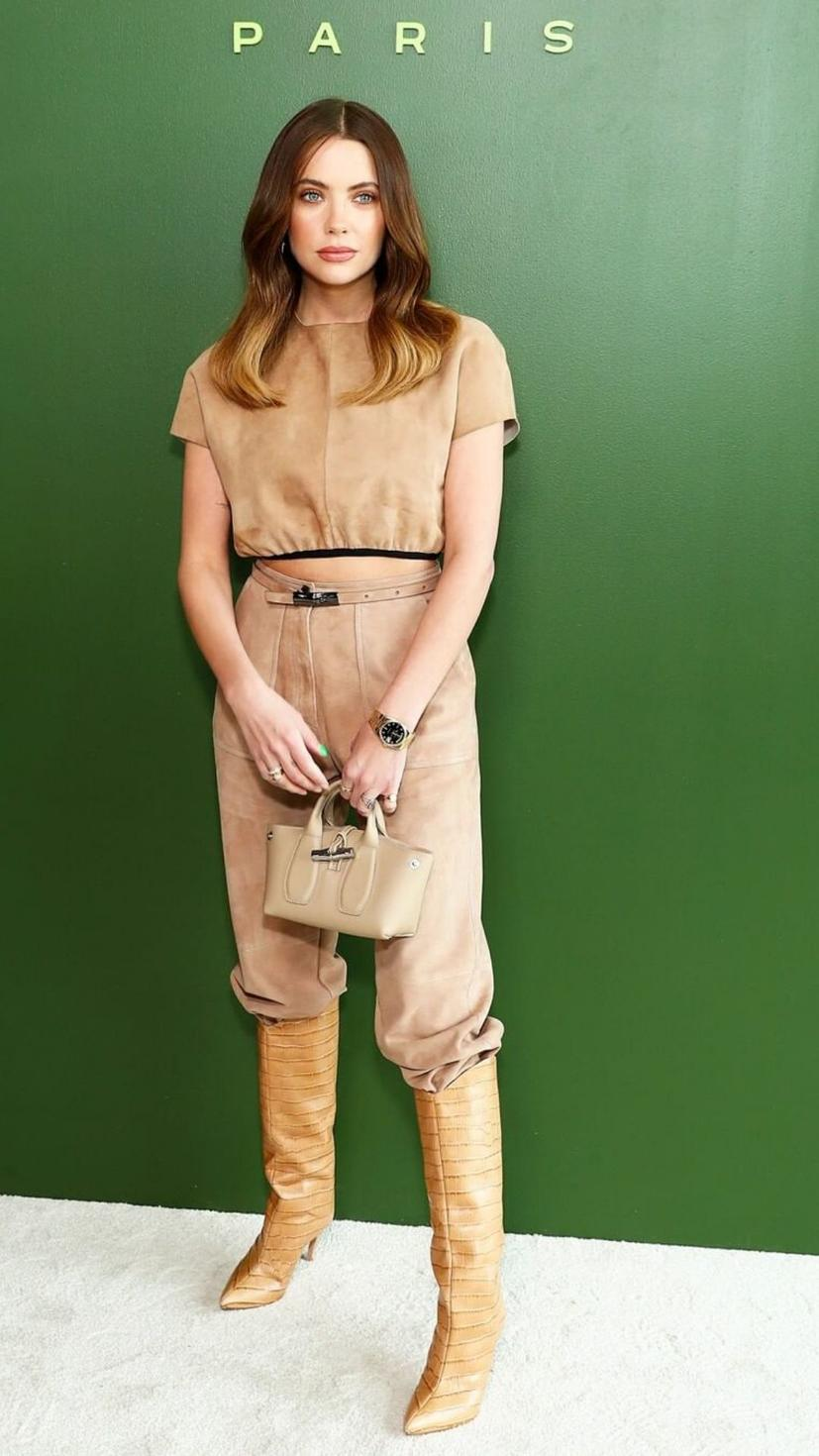 Ashley Benson attending Longchamp show wearing full outfit from the brand with matching boots from Schuts Maryana