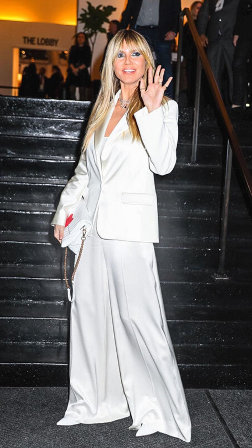 Heidi Klum at the Christian Siriano show wearing suit and heels by Christian Siriano